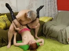 Redhead slut in stockings works out old man's penis with her cunt