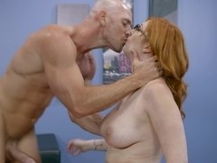 A redhead that loves cock is with her bald partner, taking in his