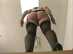 Frisky office whore in stockings gets fucked by long dildo