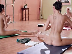 Yoga session with blonde instructress