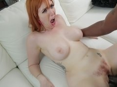 Redhead that loves big black dick is on the sofa with her partner