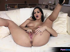 Horny brunette Eve Angel stretches her pussy