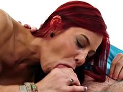 Redhead milf deepthroating and cocksucking