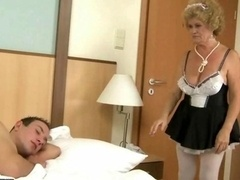 Excited mature maid fucking with a boy
