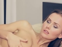 Solo Sabina Moore strips in bed and plays with her pussy