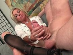 Bigtitted cougar wanks cock till cum on stockings