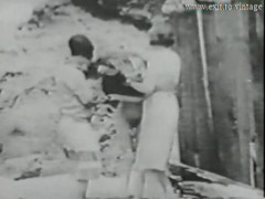 1928 Vintage With A Guy Spying Kittens On The Beach