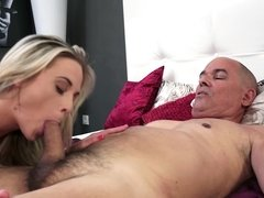 A blonde is with an old dude with a big cock, sucking him off