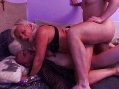 Horny granny fucked by a pair of young-looking fuck poles