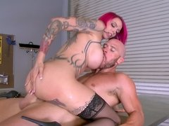 A redhead that has huge tits is getting a dick in her mouth