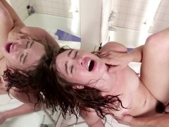 A hot chick is getting her pussy pounded in front of a mirror