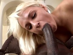 White blonde with a sexy ass is sucking a big black cock here