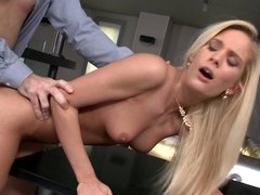 Blonde with long hair really enjoys having anal sex in the kitchen