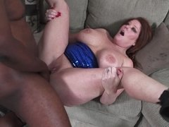 A big and busty granny is getting fucked by a big black dude