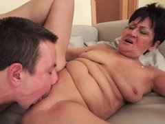 A large dude is pushing his dick into a horny old fat woman