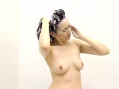 Hot Far eastern gal Solo shower