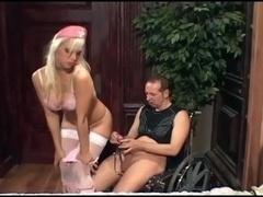 Nurse Nikki banging a gimp in boots and besides stockings