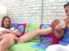 Sweet chick gives a foot massage to a small cock