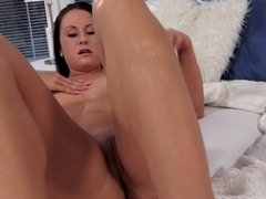 Hot chick with a shaved pussy is shoving a dildo inside her cunt