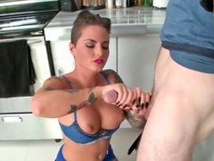 Tattooed beauty Christy Mack tugs on her man's throbbing wiener