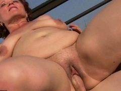 Excited weighty granny fucking a boy outdoor