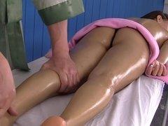 Tender hands of masseur help girl relax and get sexual pleasure