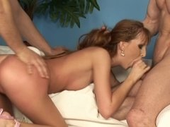 A hot little bimbo is getting rammed by two eager and large guys