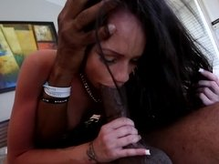 A black dude is ramming a sexy little slut with large tits