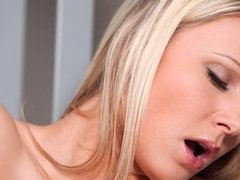Blonde tastes her own pussy juices at the bottom of the stairs
