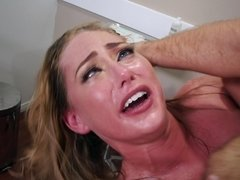 A blonde with natural tits is getting fucked in her wet pussy