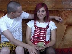 Redhead removes her clothes on the sofa and gets her cunt filled