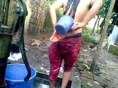 Bangla desi shameless village cousin-Nupur bathing outdoor