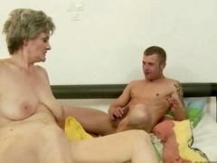 Boobalicious mature lady having an intercourse young and fresh lad