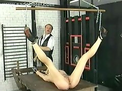 German thrall rubbing her cunt and moreover body and moreover got her legs spread by master in a dungeon