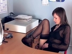 Brunette masturbates in sheer stockings and also heels