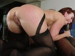 A redhead that has a sexy ass is getting her pussy lips licked