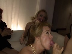 Hot amateur party babes sucking male stripper dick with their friends
