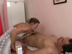 Granny masseuse gets her bushy hole nailed