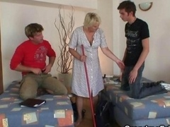 Aged cleaning woman is banged by a pair of guys