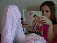 Teeanage lady is reading a porn magazine.