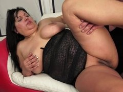 Fat old granny with large tits is massaging her large nipples