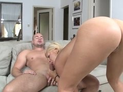 Blonde with large natural tits is doing it with a guy doggy style