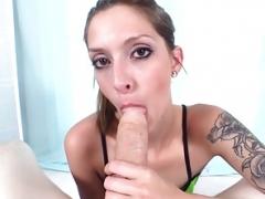 Tattooed chick edging purple rod in POV blowjob