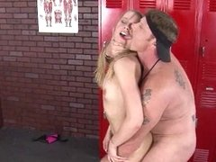 A blonde that loves to fuck is naked in the locker room, having fun