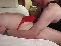 Guy in G string getting cock sucked