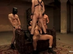 A faggot gets tortured and fucked by a few dominators in BDSM video