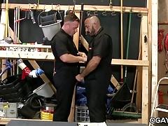 Mature gays having fun at work