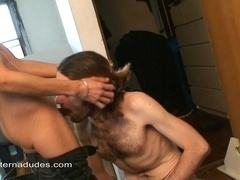 Long-haired gay gives a blowjob to his horny buddy