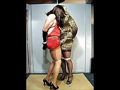 Two crossdressing sluts tied together