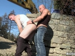 Savkov and Bruce have doggy style gay sex outdoors